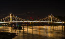 Illuminated Albert bridge at night, London, UK Stock Photos