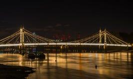 Illuminated Albert bridge at night, London, UK Stock Photos