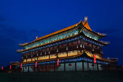 The illuminated ancient Drum Towe. R located at the ancient city wall by night time, Xian, Shanxi Province, China Royalty Free Stock Photography