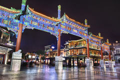 Illuminated Ancient Gate At Qianmen Street, Beijing, China Stock Photo