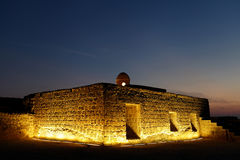 Illuminated Ancient watch tower and rooms at the upper level of Bahrain fort Stock Images