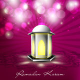 Illuminated Arabic lamp on shiny pink background Royalty Free Stock Photo