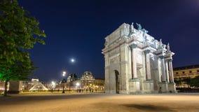 Illuminated Arc de Triomphe du Carrousel at night stock video footage