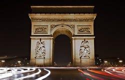 Illuminated Arc de Triomphe at night Stock Photos
