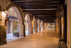 Illuminated arcades Balaguer evening view. Illuminated arcades at the main pedestrian area in the city of Balaguer in eastern Spain, Catalonia Stock Photos