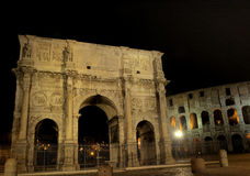 Illuminated Arch of Constantine. And Coliseum at night, Rome, Italy Royalty Free Stock Image