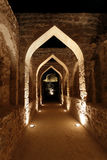 Illuminated archway inside Bahrain fort Stock Images