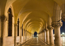 Illuminated archway of the Palazzo Ducale Royalty Free Stock Images