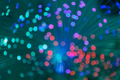 Illuminated background lights. Defocused image of optical fiber stock photos