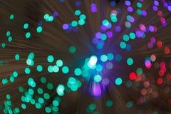 Illuminated background lights. Defocused image of optical fiber Stock Photo