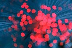 Illuminated background lights. Defocused image of optical fiber Royalty Free Stock Photography