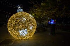 Illuminated ball of Christmas tree in the old harbor porto antico of Genoa, Italy. royalty free stock photos