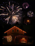 Illuminated barn and fireworks at new years eve. Midnight Stock Photography