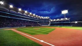 Illuminated baseball stadium with spectators and green grass Royalty Free Stock Images