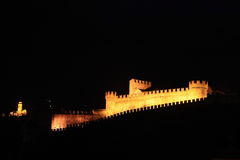 Illuminated Bellinzona castle by night Royalty Free Stock Photos