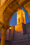 Illuminated Belltower cloister evening view Stock Image