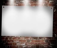 Illuminated blank banner. In the background of an old brick wall Stock Photography