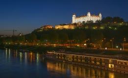 Illuminated Bratislava castle hill at night, Slovakia Stock Images