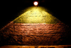 Illuminated brick wall background Stock Images
