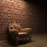 Illuminated brick wall and chair Stock Image