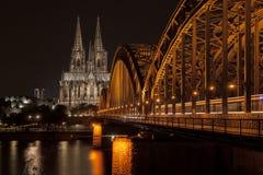 Illuminated bridge in Cologne at night Stock Photos