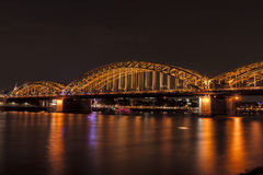 Illuminated bridge in Cologne at night Royalty Free Stock Images
