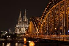 Illuminated bridge in Cologne at night Royalty Free Stock Photos