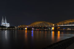 Illuminated bridge in Cologne at night Royalty Free Stock Photo