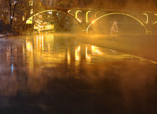 Illuminated bridge with fog Stock Image