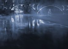 Illuminated bridge with fog Stock Images