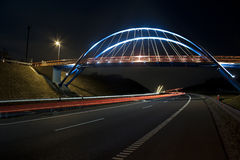 Illuminated bridge at night Stock Photography