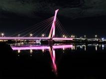 Illuminated bridge at night Stock Photos