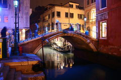 Illuminated bridge at night in Venice Royalty Free Stock Images
