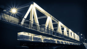 Illuminated bridge at night in winter stock photography