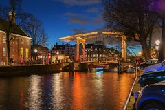 Illuminated bridge in the old town of Amsterdam in the evening Royalty Free Stock Photography