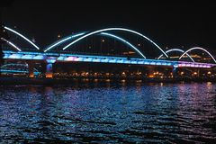 Illuminated bridge over the Pearl river in Guangzhou by night, China Royalty Free Stock Images