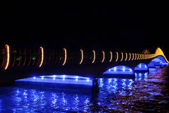 Illuminated bridge over river at night Royalty Free Stock Photo