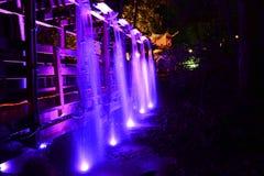 Illuminated Bridge and Waterfall Royalty Free Stock Photos