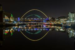 The illuminated bridges of River Tyne, Newcastle, at night royalty free stock images