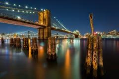 Illuminated Brooklyn Bridge by night Stock Image