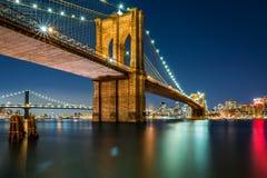 Illuminated Brooklyn Bridge by night Stock Images