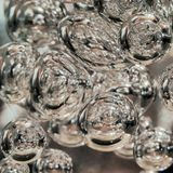 Illuminated Bubbles Floating in Clear Liquid. Abstract Background Texture. Space, Ecology, Environment, Clean Sea, Potable Water. Concept stock photography
