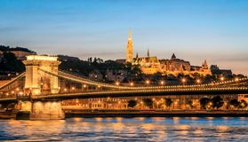 Buda Castle and the Danube. The illuminated Buda Castle and the Chain Bridge across the Danube River at the beginning of the night Royalty Free Stock Image