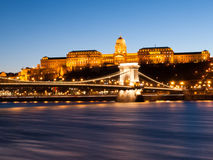 Illuminated Buda Castle and Chain Bridge over Danube River in Budapest by night, Hungary Royalty Free Stock Images