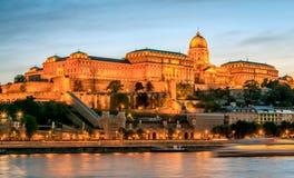 Buda Castle and the Danube. The illuminated Buda Castle and the Danube River at the beginning of the night Stock Image