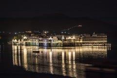 Illuminated buidling and boat over Lake Picholla, Udaipur, Rajas. Than, India Stock Image