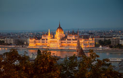 Illuminated building of the National Hungarian Parliament at night Stock Photos