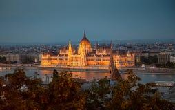 Illuminated building of the National Hungarian Parliament at night. Aerial photo Stock Photos