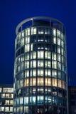 Illuminated building at night in HafenCity quarter, Hamburg, Germany royalty free stock photo