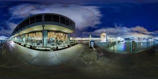 Illuminated buildings along waterfront